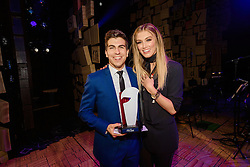 Rob Guest Endowment Recipient Daniel Assetta with Delta Goodrem at the Rob Guest Endowment Gala 2015, taken at the Lyric Theatre in Sydney, on Monday, 9 November 2015.  <br /> <br /> Hosted by David Campbell and Lucy Durack, guest artists performing at the concert included musical theatre performers Rob Mills, Caroline O'Connor and Jemma Rix, Dirty Dancing star Mark Vincent, 2014 Rob Guest Endowment winner Josh Robson, and cast members from CATS and Matilda the Musical.<br /> <br /> The six finalists for the 2015 Rob Guest Endowment are Blake Appelqvist (West Side Story, new VCA Graduate), Daniel Assetta (Cats, Wicked), Hilary Cole (Carrie, Dogfight), Georgina Hopson (Into The Woods, The Pirates of Penzance), Rob McDougall (Les Miserables, Phantom of the Opera) and Ashleigh Rubenach (Anything Goes, The Sound of Music).  The competition was judged by three of Australian musical theatre's finest creatives, Kelly Abbey, Peter Casey and Gale Edwards.<br /> <br /> The 2015 recipient was Daniel Assetta.