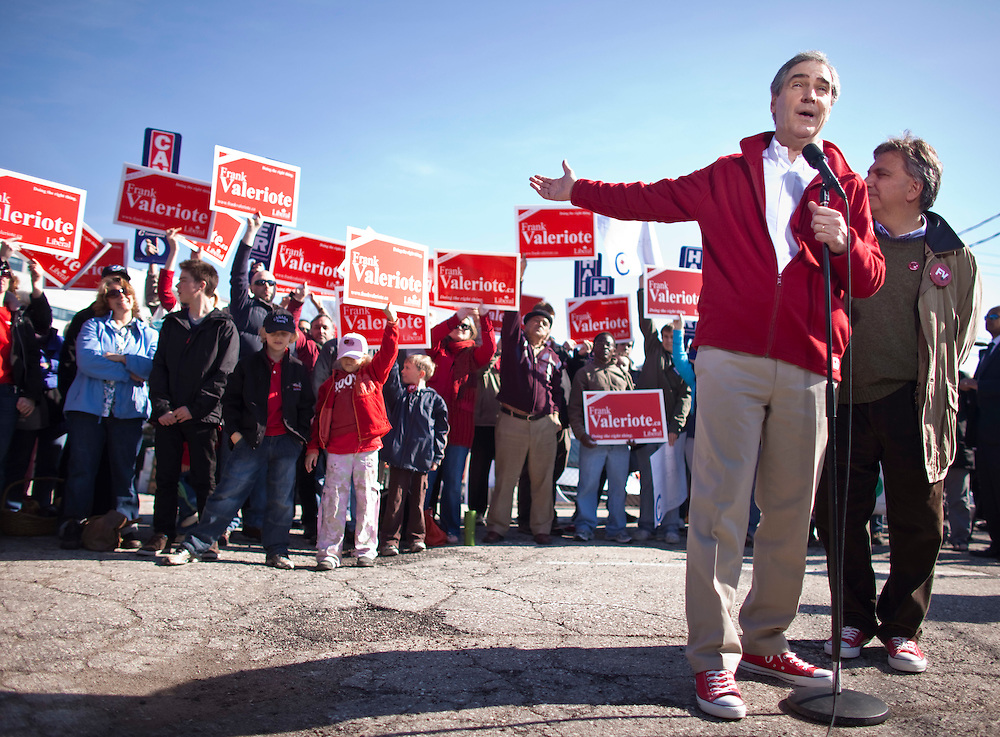 Liberal leader Michael Ignatieff welcomes the conservative supporters who joined his press conference with their &quot;Harper&quot; signs during a campaign stop in Guelph, Ontario, April 30, 2011.<br /> REUTERS/Geoff Robins