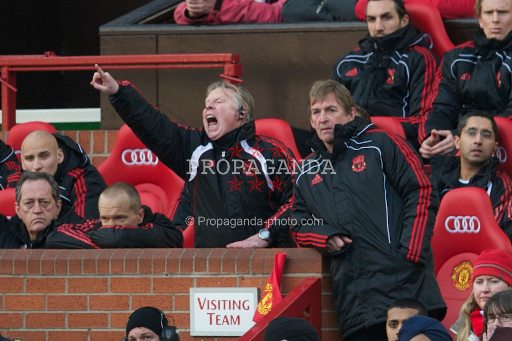 MANCHESTER, ENGLAND - Sunday, January 9, 2011: Liverpool's assistant manager Sammy Lee and manager Kenny Dalglish MBE during the FA Cup 3rd Round match against Manchester United at Old Trafford. (Photo by: David Rawcliffe/Propaganda)
