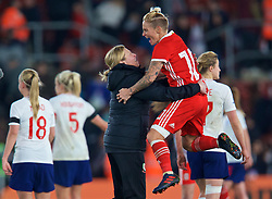 SOUTHAMPTON, ENGLAND - Friday, April 6, 2018: Wales' manager Jayne Ludlow and Jessica Fishlock celebrate at the final whistle after a hard fought goal-less draw against England during the FIFA Women's World Cup 2019 Qualifying Round Group 1 match between England and Wales at St. Mary's Stadium. (Pic by David Rawcliffe/Propaganda)