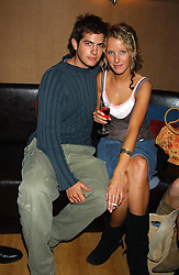 MISS KATE MELHUISH and JACK FREUD at a party to celebrate the opening of Ishtar - a new mediterainian restaurant in Crawford Street, London W1 on 15th September 2004.<br />