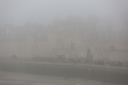 © Licensed to London News Pictures. 17/12/2016. LONDON, UK.  The Tower of London during foggy weather this morning. London and the River Thames was shrouded in thick fog this morning.  Photo credit: Vickie Flores/LNP