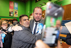 © Licensed to London News Pictures . 13/12/2019. Bury, UK. JAMES DALY (c) cries as conservatives celebrate their narrow win in the Bury North count after Labour candidate James Frith conceded to James Daly following a recount , at the count for seats in the constituencies of Bury North and Bury South in the 2019 UK General Election , at Castle Leisure Centre in Bury . Photo credit: Joel Goodman/LNP