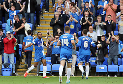 Peterborough United's Britt Assombalonga celebrates scoring the opening goal  - Photo mandatory by-line: Joe Dent/JMP - Tel: Mobile: 07966 386802 17/08/2013 - SPORT - FOOTBALL - London Road Stadium - Peterborough -  Peterborough United V Oldham Athletic - Sky Bet League One