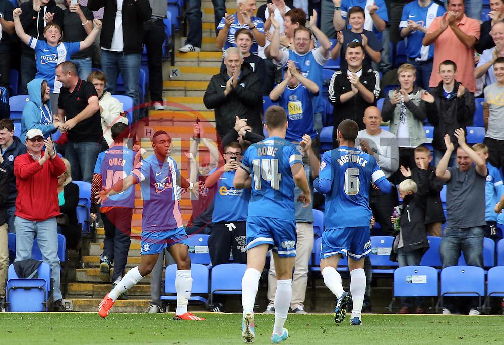 Peterborough United's Britt Assombalonga celebrates scoring the opening goal  - Photo mandatory by-line: Joe Dent/JMP - Tel: Mobile: 07966 386802 17/08/2013 - SPORT - FOOTBALL - London Road Stadium - Peterborough -  Peterborough United V Oldham Athletic - Sky Bet League One