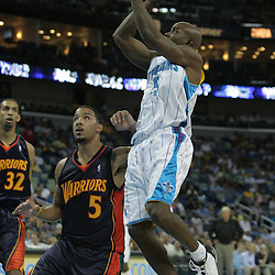 05 October 2008: New Orleans Hornets guard Mike James (5) shoots over Golden State Warriors guard Marcus Williams (5) during a NBA preseason game between the Golden State Warriors and the New Orleans Hornets at at the New Orleans Arena in New Orleans, LA..