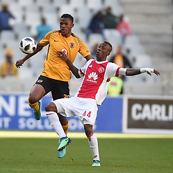 Cape Town-180512   Kaizer Chiefs  defender Siyabonga Ngezana challenges  Yannick Zakri  of Ajax Cape Town in the last game of the PSL at Cape Town stadium.photographer:Phando Jikelo/African News Agency/ANA