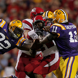 19 September 2009: Louisiana-Lafayette Cajuns running back Draylon Booker (29) is tackled by LSU Tigers defenders Drake Nevis (92) and Kelvin Sheppard (11) during 31-3 win by the LSU Tigers over the University of Louisiana Lafayette Ragin' Cajuns at Tiger Stadium in Baton Rouge, Louisiana.