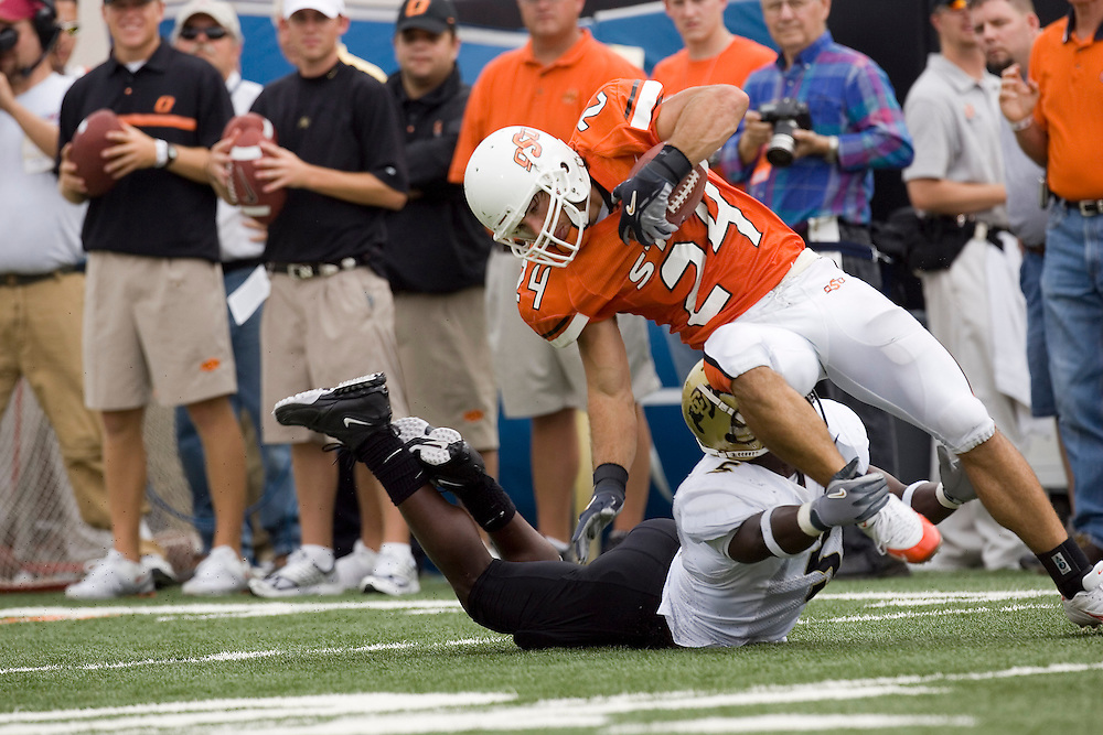 Oklahoma State Cowboys wide receiver Luke Frazier gets tackled after catching a pass during a 34 to 0 loss to the Colorado Buffaloes on October 1, 2005 at Boone Pickens Stadium in Stillwater, Oklahoma.
