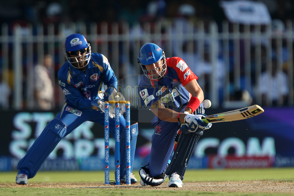 Kevin Pietersen captain of of the Delhi Daredevils life the ball over the keeper during match 16 of the Pepsi Indian Premier League 2014 between the Delhi Daredevils and the Mumbai Indians held at the Sharjah Cricket Stadium, Sharjah, United Arab Emirates on the 27th April 2014<br /> <br /> Photo by Ron Gaunt / IPL / SPORTZPICS