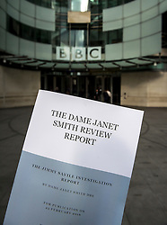 © Licensed to London News Pictures. 25/02/2016. London, UK.  A copy of a report in to abuse by DJ Jimmy Savile held at the front of BBC Broadcasting House in London. The Dame Janet Smith review found that the BBC repeatedly failed to stop abuse by DJ Jimmy Savile and broadcaster Stuart Hall. Photo credit: Ben Cawthra/LNP