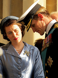 © Licensed to London News Pictures. 25/10/2015. London, UK. MATT SMITH and CLAIRE FOY pictured during  filming of the new Netflix series, 'The Crown' taking place at the Old Royal Naval College in Greenwich, London . Photo credit : Graham Long/LNP