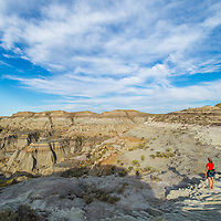 hiker on ridge in badlands of eastern montana near fort peck lake