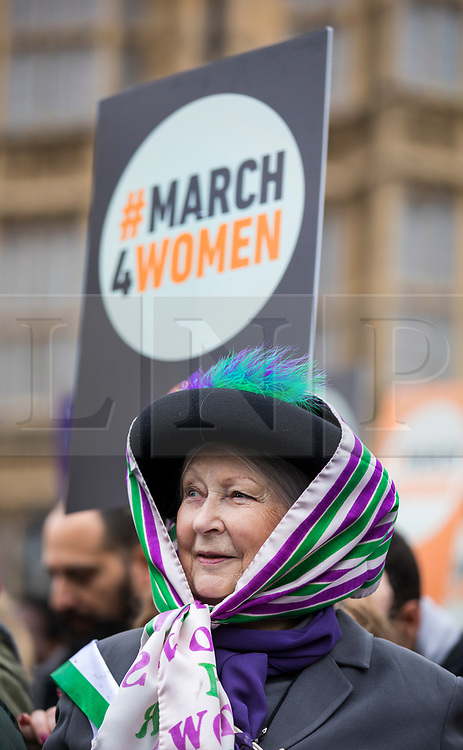 © Licensed to London News Pictures. 04/03/2018. London, UK. A woman dressed as a Suffragette at March 4 Women which marks the centenary of the Representation of the People's Act 1918 by retracing the steps of the Suffragettes from Parliament to Trafalgar Square. Photo credit: Rob Pinney/LNP