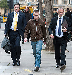 © London News Pictures. 16/03/2012. London, UK. RYAN ACKROYD (centre) leaving Westminster Magistrates Court with his solicitors (left and right) on March 16th, 2012 where he faced charges in connection with alleged computer crime. RYAN ACKROYD is accused of involvement in the elite hacking organisation known as Lulz Security aka LulzSec. LulzSec are accused of multiple cyber attacks on the computer systems of various businesses and governments in the United State. Photo credit : Ben Cawthra/LNP