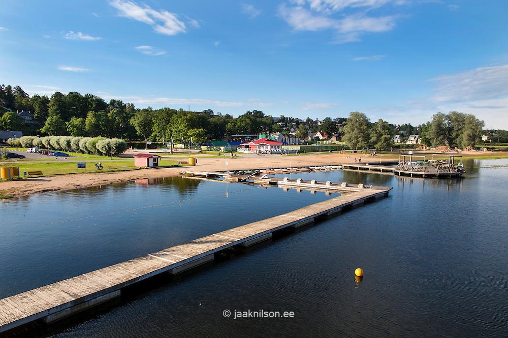Wooden floating boardwalk on Viljandi lake in Estonia. Waterfront, beach and rest area.