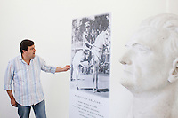 """AFFILE, ITALY - 23 AUGUST 2012: Mayor of Affile Ercole Viri, 52, stands by a board and a bust of fascist Marshall Rodolfo Graziani in the mausoleum dedicated to him in Affile, a town with a population of 1,600 80km east of Rome, on August 23, 2012. A mausoleum and park, dedicated to the memory of Fascist Field Marshall Rodolfo Graziani, has recently been opened in the Italian town of Affile. At a cost of €127,000 to local taxpayers, the mayor Ercole Viri has expressed hope that the site will become as 'famous and as popular as Predappio' – the burial place of Mussolini which has become a shrine to neo-Fascists. Rodolfo Graziani was the youngest colonel in the Regio Esercito (Royal Italian Army), known as the """"Butcher of Fezzan"""" and the """"Butcher of Ethiopia"""" for the brutal military campaigns and gas attacks he led in Libya and Ethiopia under the dictatorship of Benito Mussolini under which he then became Minister of Defence from 1943 to 1945."""