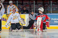 KELOWNA, CANADA - OCTOBER 25: Logan Thompson #1 of Brandon Wheat Kings and Jake Morrissey #31 of Kelowna Rockets converse during warm up on October 25, 2014 at Prospera Place in Kelowna, British Columbia, Canada.  (Photo by Marissa Baecker/Shoot the Breeze)  *** Local Caption *** Logan Thompson; Jake Morrissey;