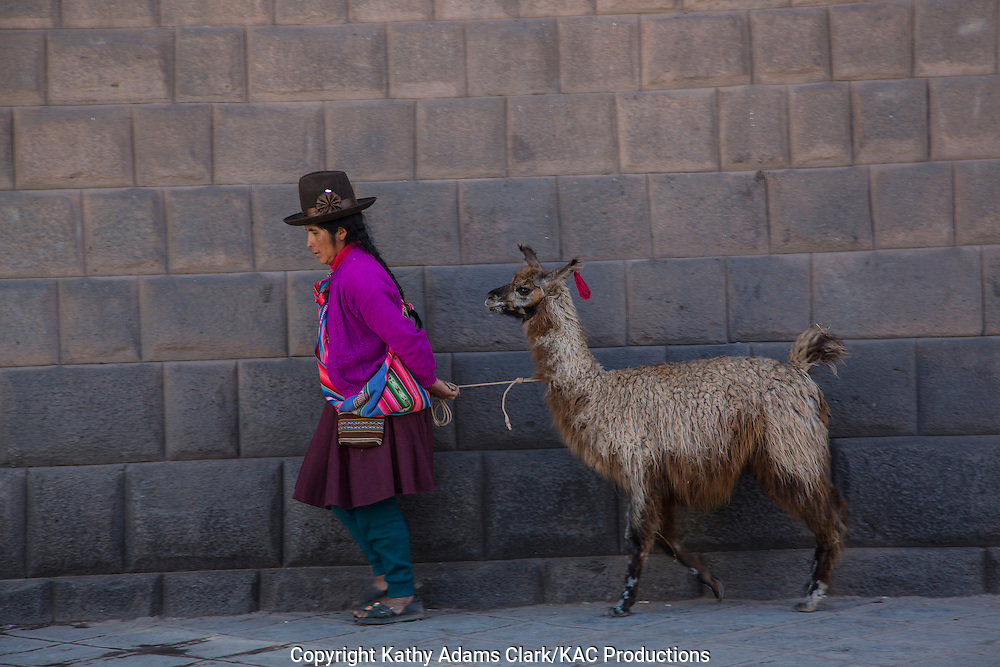 Lady in traditional dress, with a llama, in Cusco, Peru.