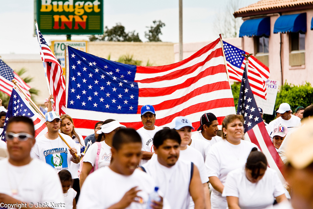 10 APRIL 2006 - PHOENIX, AZ: More than 200,000 people participated in a march for immigrants's rights in Phoenix Monday. The march was a part of a national day of action on behalf of undocumented immigrants. There were more than 100 such demonstrations across the US Monday. Protestors were encouraged to wear white, to symbolize peace, and wave American flags, to demonstrate their patriotism to the US.  Photo by Jack Kurtz