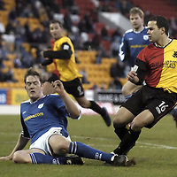 St Johnstone v Partick Thistle..22.01.05<br />Ian Maxwell can't prevent Leigh Hinds equalising for Partick.<br /><br />Picture by Graeme Hart.<br />Copyright Perthshire Picture Agency<br />Tel: 01738 623350  Mobile: 07990 594431