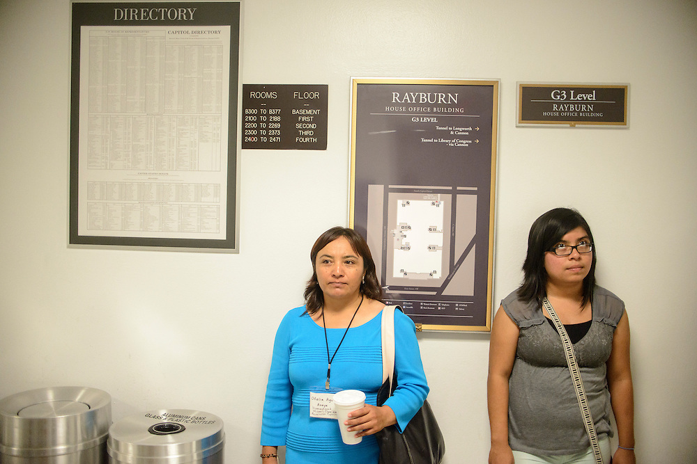 Photo by Matt Roth<br /> <br /> Florida Farmworker Fly In constituents Ofelia Aguilar and <br /> Selena Zelaya wait for the elevator in the Rayburn House Building in Washington, D.C. on Tuesday, July 16, 2013 before meeting with Lee Footer, Legislative Assistant for Agriculture &amp; Environmental Policy for Rep. Corrine Brown.