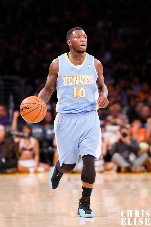 05 January 2014: Denver Nuggets point guard Nate Robinson (10) brings the ball upcourt during the Denver Nuggets  137-115 victory over the Los Angeles Lakers at the Staples Center, Los Angeles, California, USA.
