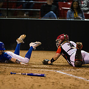 15 February 2018: The San Diego State softball team hosts #25 Kentucky to open up the 28th annual Campbell/Cartier Classic. Kentucky catcher Bailey Vick (2) slides past San Diego State catcher Molly Sturdivant (31) in the fourth inning. The Aztecs lost to the Wildcats 5-0.<br /> More game action at www.sdsuaztecphotos.com