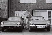 Teenager with Triumph Spitfires outside council house, UK, 1984