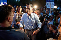 Mitt Romney works his way through the crowd gathered at Rollins Park in Concord for the Tea Party Express Tour Sunday evening.  (Karen Bobotas/for the Concord Monitor)
