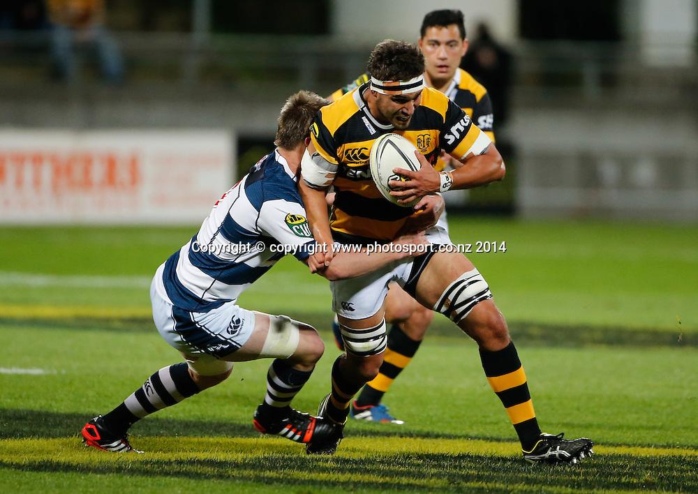 Taranaki's Riki Hoeata is tackled. ITM Cup Rugby, Taranaki v Auckland, Yarrow Stadium, New Plymouth, New Zealand. Friday, 26 September, 2014. Photo: John Cowpland / www.photosport.co.nz