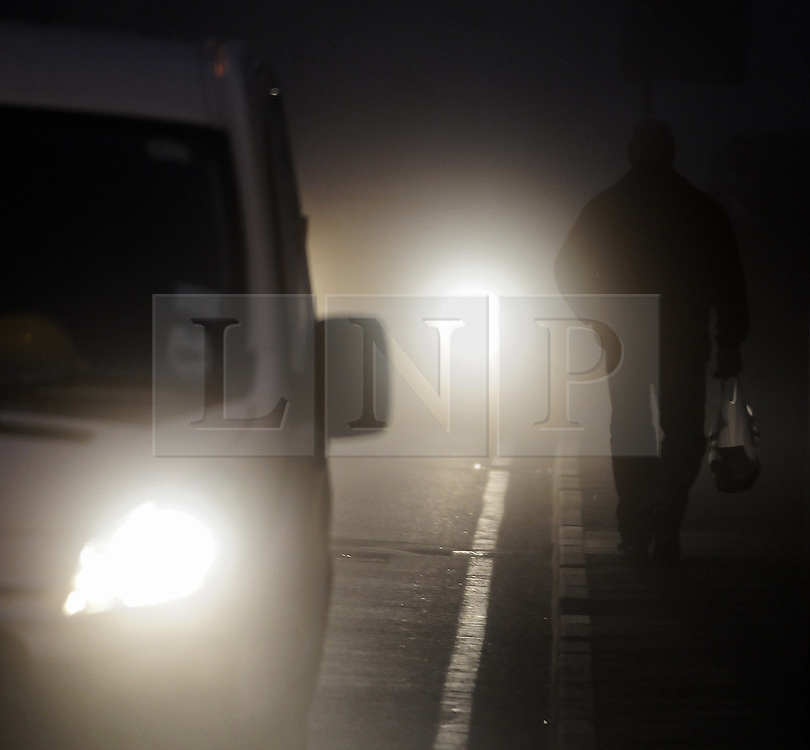 © Licensed to London News Pictures. 15/11/2012. A Commuters  in the borough of Bromley, Kent, South East London border walking to work in the fog this morning as temperatures drop in the South East..Photo credit : Grant Falvey/LNP