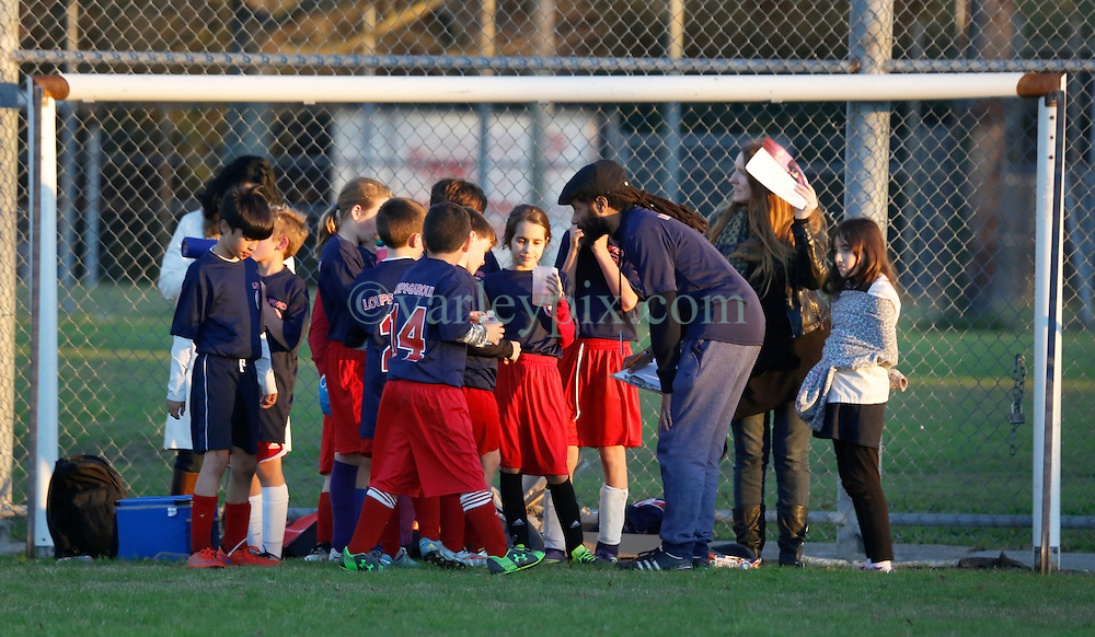 28 January 2016. New Orleans, Louisiana.<br /> The Loups Garoux soccer team comprising 4th and 5th graders take to the field at Cuccia Byrnes for their first ever appearance making history for Lyce&eacute; Francais de la Nouvelle Orleans. The Loups Garoux had to lend opponents Holy Name the entire 5th grade to make up the numbers in a thrilling 6-8 game with Holy Name emerging victorious at the end.<br /> Photo&copy;; Charlie Varley/varleypix.com