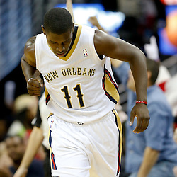 Dec 13, 2013; New Orleans, LA, USA; New Orleans Pelicans point guard Jrue Holiday (11) reacts after hitting a three point basket against the Memphis Grizzlies during the fourth quarter of a game at New Orleans Arena. The Pelicans defeated the Grizzlies 104-98. Mandatory Credit: Derick E. Hingle-USA TODAY Sports