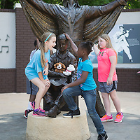 Lauren Wood | Buy at photos.djournal.com<br /> Third graders Katie Nock, from left, Ya'Leah Mundy and Tori McDonald play with near the Elvis statues Wednesday morning during a field trip with other Saltillo Elementary School third graders to the Elvis Presley Birthplace and Veterans Park.