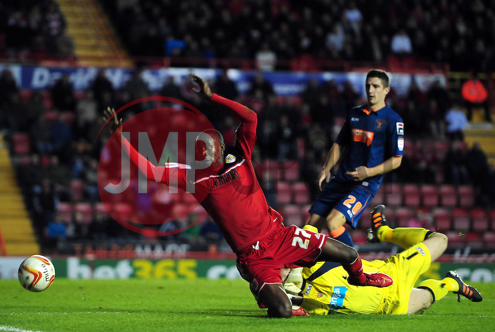 Bristol City's Albert Adomah is fouled by Blackpool's Matthew Gilks to concede a penalty scored by Bristol City's Steven Davies - Photo mandatory by-line: Joe Meredith/JMP  - Tel: Mobile:07966 386802 17/11/2012 - Bristol City v Blackpool - SPORT - FOOTBALL - Championship -  Bristol  - Ashton Gate Stadium -