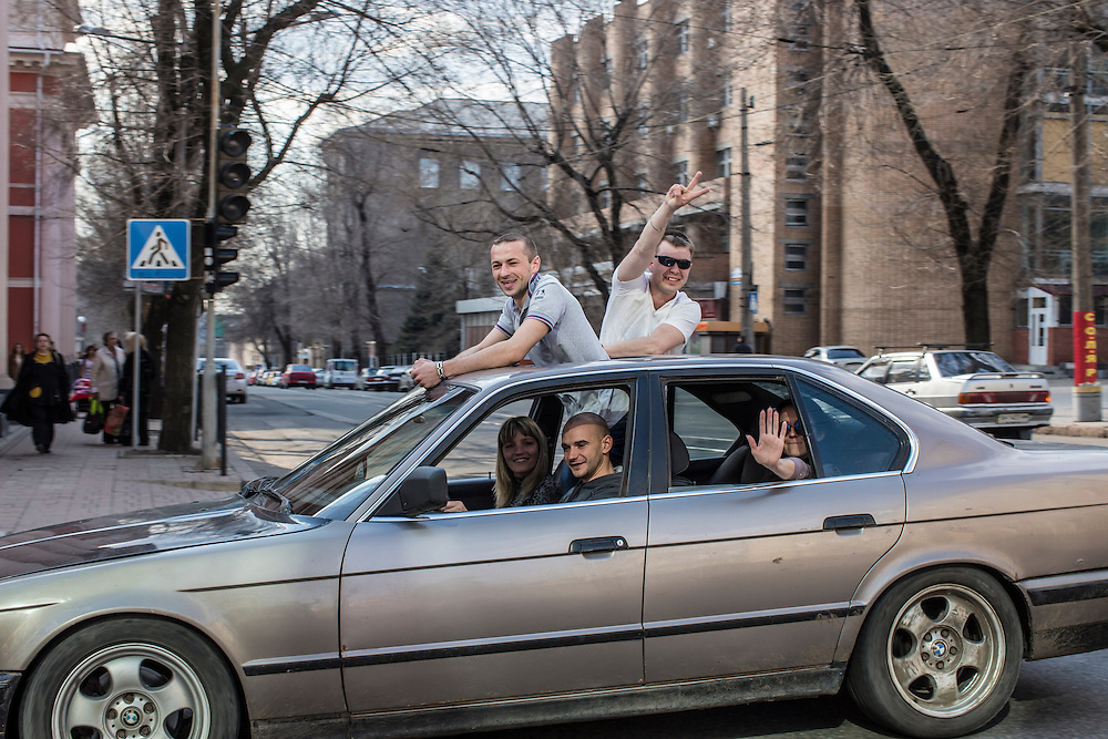 Men celebrate while driving through town on Sunday, April 12, 2015 in Donetsk, Ukraine.