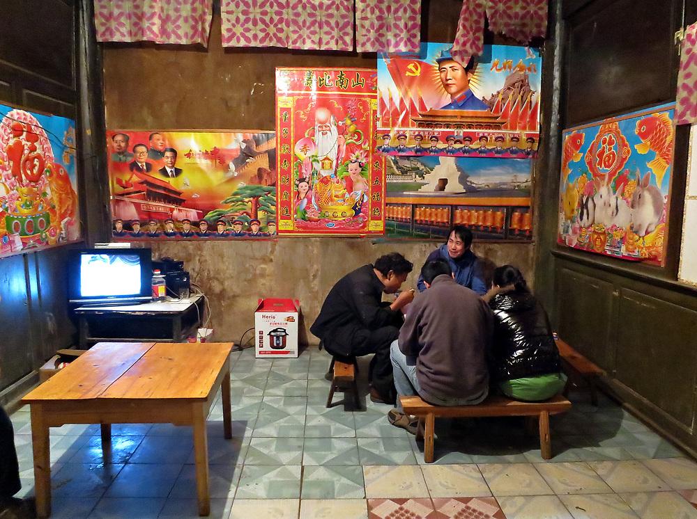 Dinner under Mao's gaze at Xidang Spring, Yunnan, China; September, 2013.