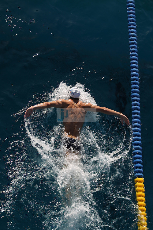 SANTA CLARA, CA - JUNE 17:  Michael Phelps warms up in the practice pool during day 2 of the Santa Clara International Grand Prix at George F. Haines International Swim Center on June 17, 2011 in Santa Clara, California.  (Photo by Jed Jacobsohn)