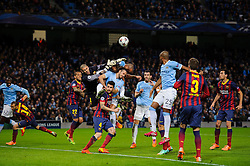 Barcelona Goalkeeper Victor Valdes (ESP) saves from Man City Defender Vincent Kompany (BEL) - Photo mandatory by-line: Rogan Thomson/JMP - Tel: 07966 386802 - 18/02/2014 - SPORT - FOOTBALL - Etihad Stadium, Manchester - Manchester City v Barcelona - UEFA Champions League, Round of 16, First leg.
