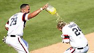 CHICAGO - JULY 30:  Matt Davidson #24 is doused with Gatorade by Jose Abreu #79 of the Chicago White Sox after Davidson hit a two-run, walk-off game winning home run in the bottom of the ninth inning against the Cleveland Indians on July 31, 2017 at Guaranteed Rate Field in Chicago, Illinois.  The White Sox defeated the Indians 3-1.  (Photo by Ron Vesely) Subject:   Matt Davidson; Jose Abreu