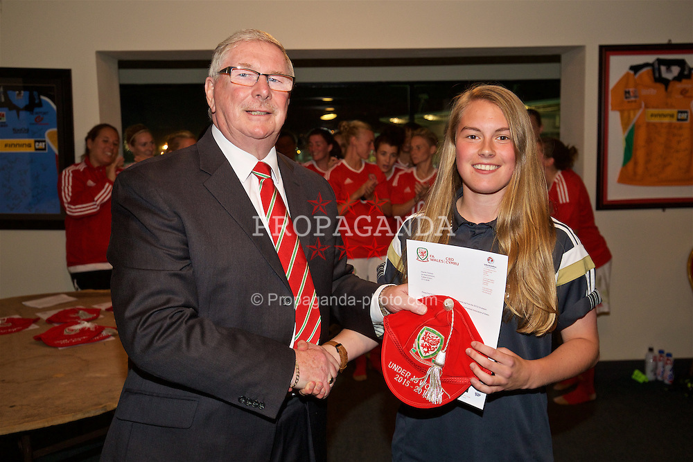 CARDIFF, WALES - Friday, August 19, 2016: Wales' Niamh Tinman is presented with her Under-19 cap by FAW President David Griffiths at Rodney Parade. (Pic by David Rawcliffe/Propaganda)