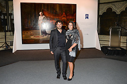 """Artist RALPH HEIMANS and his wife TAMI at a private view to view """"The Coronation Theatre: Portrait of Her Majesty Queen Elizabeth II"""" painted by Ralph Heimans held at Westminster Abbey, London on 12th September 2013."""