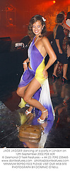 JADE JAGGER dancing at a party in London on 12th September 2002.PDE 609