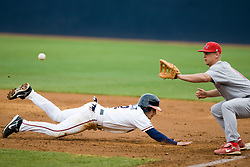 Virginia Cavaliers INF Greg Miclat (2) beats a throw to Radford Highlanders 1B Alex Gregory (14).  The #16 ranked Virginia Cavaliers baseball team defeated the Radford Highlanders 8-2 at the University of Virginia's Davenport Field in Charlottesville, VA on March 11, 2008.