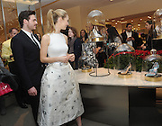 "The stars of Disney's live action film ""Cinderella,"" Lily James and Richard Madden, admire the Disney-curated collection of nine luxury designer shoes that re-imagine the iconic glass slipper from the film at 10022-SHOE, Saks Fifth Avenue's dedicated shoe zip code, Monday, March 9, 2015, in New York. The shoes are for sale exclusively at Saks in the U.S. ""Cinderella"" opens in theaters nationwide on March 13.  (Photo by Diane Bondareff/ Invision for Disney Consumer Products/AP Images)"