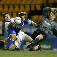 St Johnstone v Ross County...02.01.2007<br />Peter MacDonald is blocked by Sean Webb and Craig Samson<br /><br />Picture by Graeme Hart.<br />Copyright Perthshire Picture Agency<br />Tel: 01738 623350  Mobile: 07990 594431