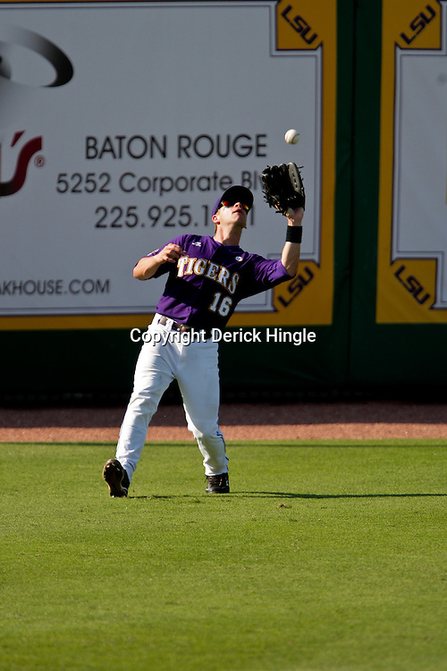 06 June 2009:  LSU outfielder Ryan Schimpf (16) fields a pop fly during a 5-3 victory by the LSU Tigers over the Rice Owls in game two of the NCAA baseball College World Series, Super Regional played at Alex Box Stadium in Baton Rouge, Louisiana. The Tigers with the win advance to next week's College Baseball World Series in Omaha, Nebraska.