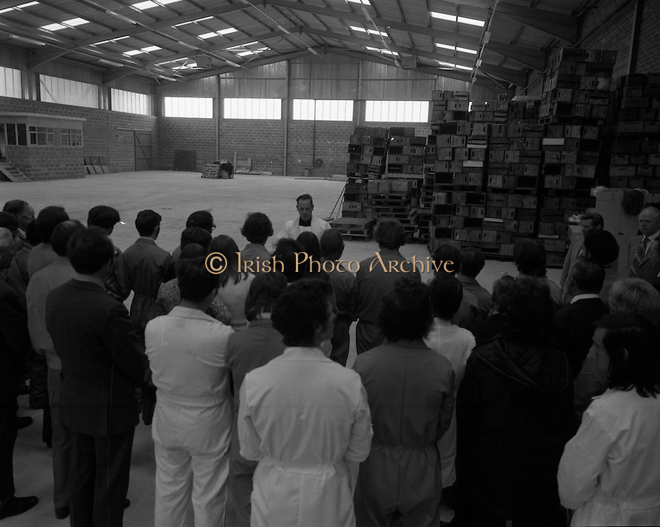 New Bottling plant for D.E.Williams..1975..19.06.1975..06.19.1975..19th June 1975..The Minister for Justice, Mr Patrick Cooney TD, officially opened the new one and a half million gallon per annum soft drink facility at Tullamore,Co Offaly. The new plant represents an investment of over a quarter million pounds by the Williams Group. It is hoped that this investment will create further employment for the area...To celebrate the opening of the new facility the local priest is pictured blessing the factory and all therin prior to switching on of the new machinery.