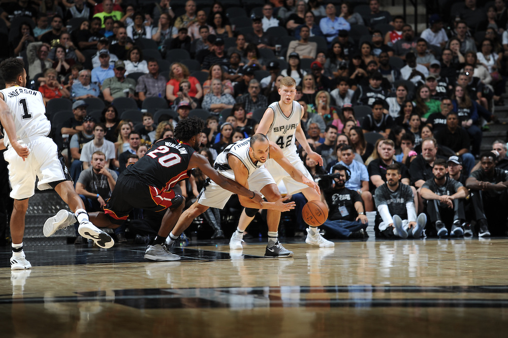 SAN ANTONIO TX - OCTOBER 14:   XXX of the San Antionio Spurs drives to the basket against the Miami Heat on October 14 at the AT&T Center in San Antonio, Texas.  NOTE TO USER: User expressly acknowledges and agrees that, by downloading and or using this photograph, User is consenting to the terms and conditions of the Getty Images License Agreement. Mandatory Copyright Notice: Copyright 2016 NBAE (Photo by Mark Sobhani/NBAE via Getty Images)